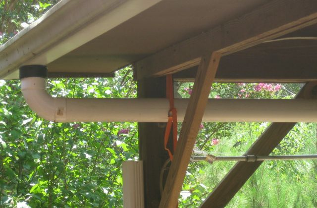 """a straight downward run. I should mention that a 90 degree 4"""" thinwall joint has a smaller internal diameter than 4"""" thick wall but I found a corrugated pipe connector which fits inside the elbow and has a wider internal diameter to accommodate the gutter downspout"""