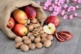 sack of nut and red delicious apples with flowers