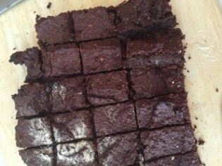 Cut up brownies with a few ends missing.