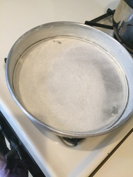 Greased pan with gluten free mix spread onto pan.