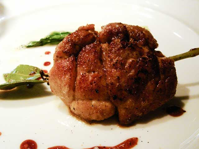 A Sauteed Sweetbread (Type of Organ Meat) On a Plate.