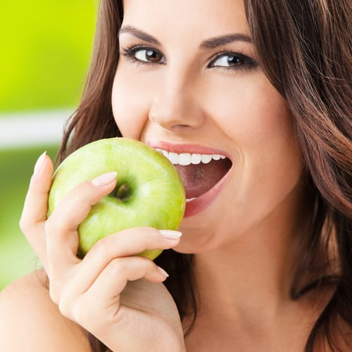 Lady eating a apple