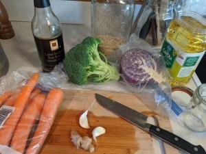 stir fry ingredients: garlic, ginger, cooking oil, veggies, soy sauce
