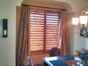 knotty alder shutters with side panels in Castle Rock, CO