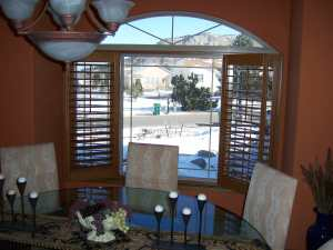 wood shutters with open arch in Denver, CO