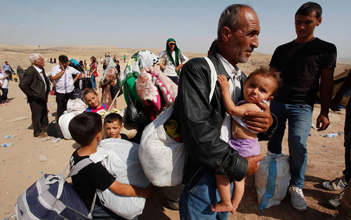 https://i2.wp.com/www.nwasianweekly.com/wp-content/uploads/2015/34_49/com_refugee.jpg?resize=500%2C313