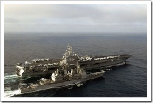USS Ronald Reagan (CVN-76) and USS Lake Champlain (CG-57)