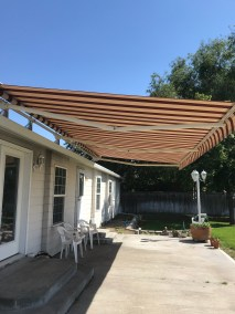 Tucson Retractable Awning Havelock Brick Fabric with motor and sensor