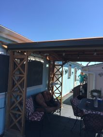 Mocha Fabric Patio Shade Rolled Up
