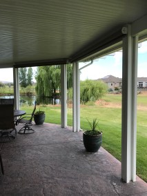 Exposed Roll Mocha Solar Shade Rolled Up