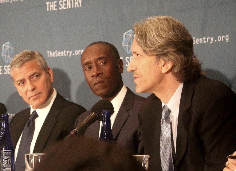 Actors George Clooney (L) and Don Cheadle (C) appear with author John Prendergast at the National Press Club, Sept. 14, to discuss the findings of a two-year investigation into the networks of corrupt South Sudan's senior officials(Photo: Gary Feuerberg/Epoch Times)