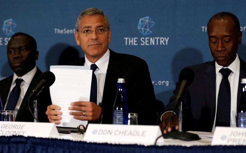 George Clooney (C), with fellow actor Don Cheadle (R) and The Sentry investigative journalist Brian Adeba (L), discuss The Sentry's investigation of the role of national corruption in the ongoing humanitarian crisis in South Sudan during a news conference at the National Press Club in Washington, U.S. September 12, 2016(Photo credit: REUTERS/Jonathan Ernst)
