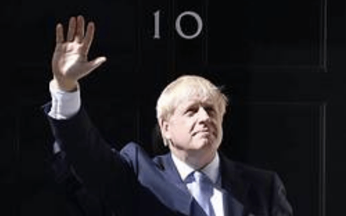New British Prime Minister Boris Johnson waves from the door of No. 10 Downing Street | Jeff J Mitchell/Getty Images