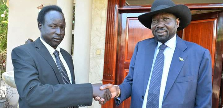South Sudan President Salva Kiir, right, greeting defecting SPLA-IO commander General Ochan Puot in Juba (File/Supplied/Nyamilepedia)