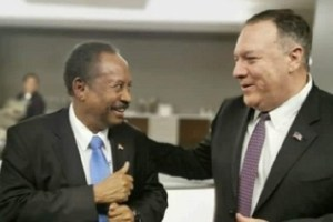 US secretary of state Michael Pompeo [right] gestures with Sudanese Prime Minister Abdallah Hamdok [left] as talk to lift Sudan from list of state sponsor of terrorism continues (Photo via Sudan Tribune)