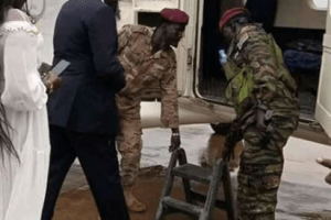 Dr. Nguen Manytuil boarding a plane in South Sudan capital, Juba(Photo credit: supplied)