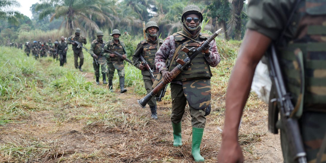 theCongolese soldiers from the Armed Forces of the Democratic Republic of Congo (FARDC) walk in line after the army took over an ADF rebel camp, near the town of Kimbau, North Kivu Province, Democratic Republic of Congo, February 20, 2018(Photo credit: Reuters/Nyamilepedia)