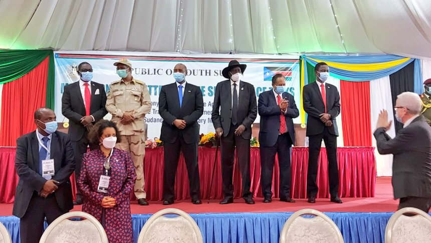 Sudanese leaders post for a picture with mediators after signing the long awaited peace deal in Juba, South Sudan(Photo credit: supplied/Nyamilepedia)