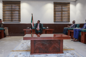 ICC Prosecutor Fatou Bom Bensouda, Minister of Justice Nasreldin Abdelbari and Sudanese Prime Minister Abdalla Hamdok meeting in Khartoum, Sudan on October 18, 2020(Photo credit: courtesy image/Hamdok twitter handle, customized by Nyamilepedia)
