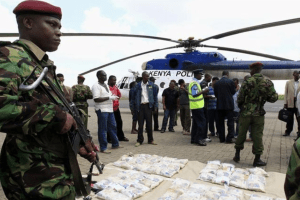 A Kenyan policeman guards seized drugs from the port city of Mombasa at Wilson airport in the capital Nairobi (Photo credit: REUTERS/Thomas Mukoya)