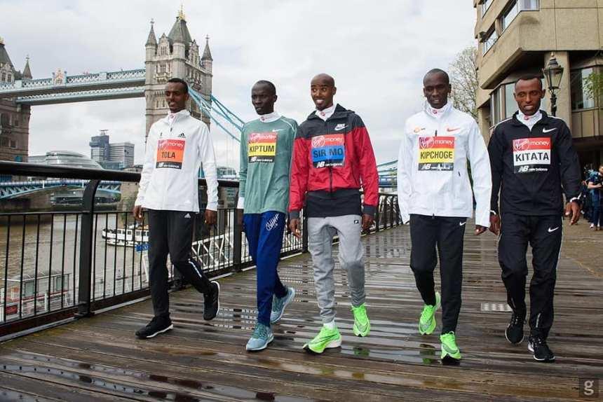 Eluid Kipchonge, Shura Kitata and Kitum matching on the street in London before their London Marathon race(Photo credit: supplied/Nyamilepedia)