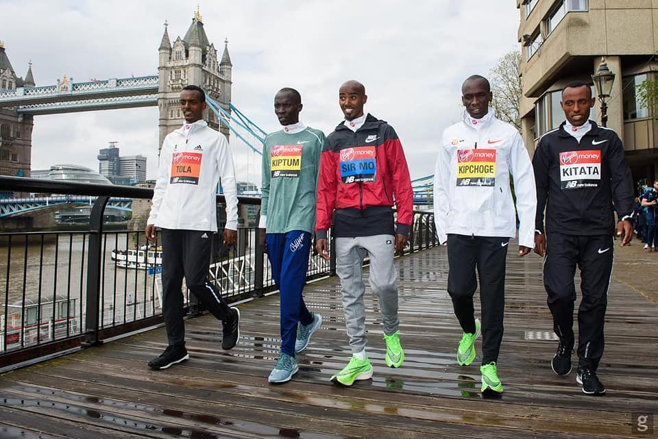 Eluid Kipchonge, Shura Kitata and Kitum matching on the street in London before their London Marathon race(Photo credit: supplied/Nyamilepedia)
