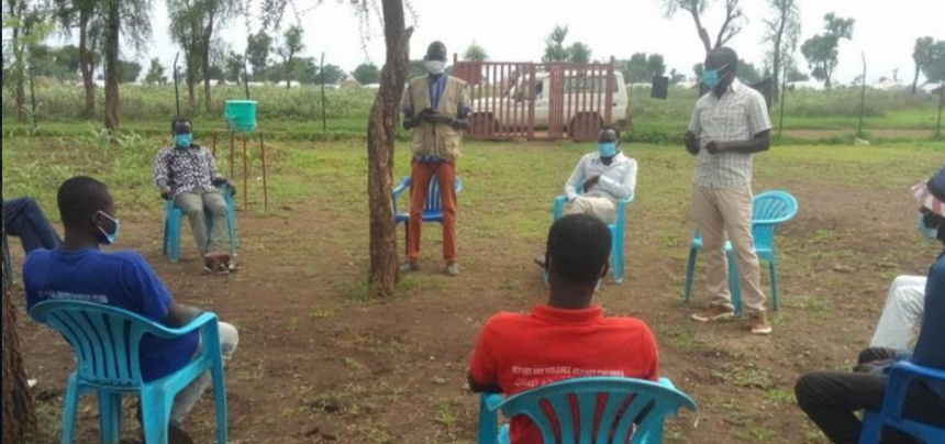 Emad, DAFI student (standing right), conducts a COVID-19 awareness session with youth leaders in a Maban refugee camp on July 3, 2020(Photo credit: LWF/Annet Kenyi )