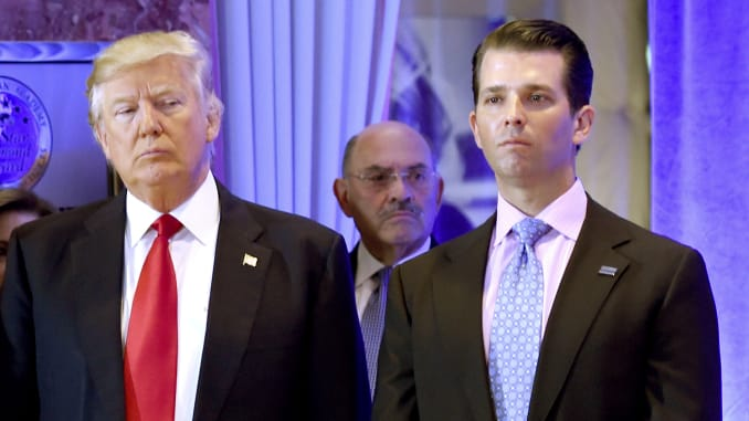 US President-elect Donald Trump along with his son Donald, Jr., arrive for a press conference at Trump Tower in New York, as Allen Weisselberg (C), chief financial officer of The Trump, looks on.(Photo credit: Timothy A. Clary | AFP | Getty Images)