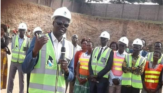 Dr. Chol Deng Thon at the construction site of Nilepet Headquarters in Juba(Photo credit: supplied)