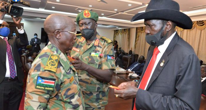 President Salva Kiir Mayardit putting new ranks on Gen. Santino Deng Wol the new Chief of Defence Forces(Photo credit: courtesy image/Nyamilepedia)