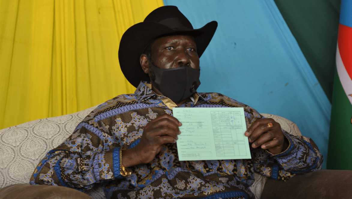 President Salva Kiir showing off his COVID-19 Certificate after receiving his first does of AstraZeneca vaccine(Photo credit: courtesy image)