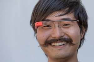 Deny Le is wearing Google Glass out of attorney office.