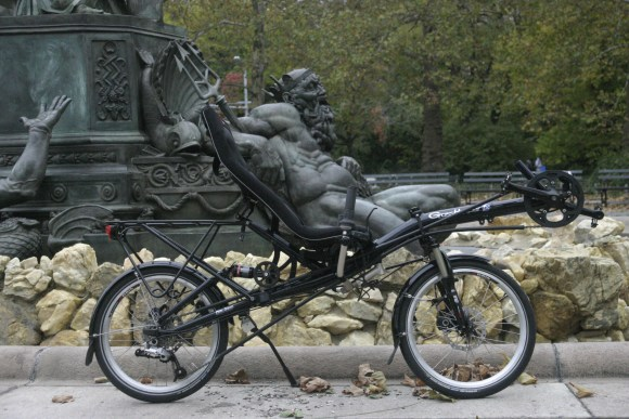 Neptune almost riding a recumbent bike at Grand Army Plaza, Brooklyn, New York.