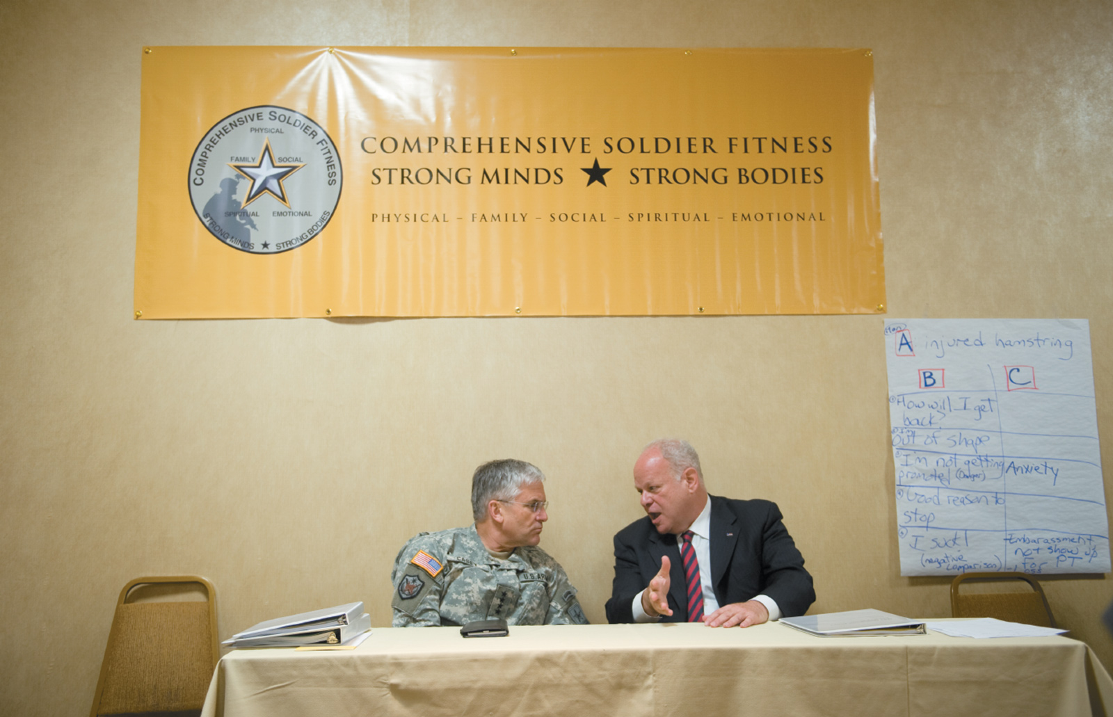 Army Chief of Staff General George W. Casey with Martin Seligman, the founder of the Positive Psychology movement and developer of the theory of 'learned helplessness,' at the Comprehensive Soldier Fitness program at the University of Pennsylvania, Philadelphia, May 2009