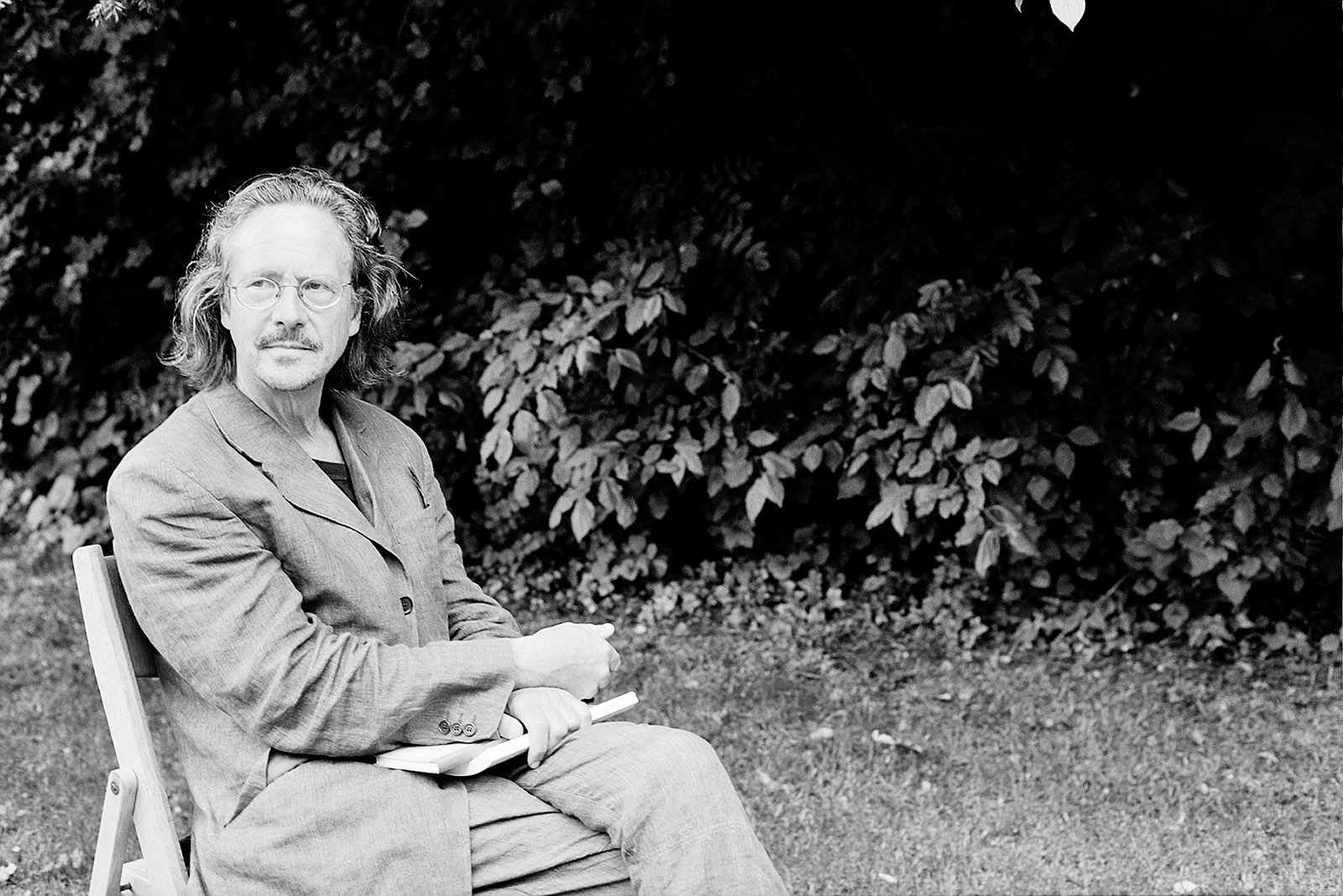 Peter Handke in the garden of Bartenstein Castle, Schrozberg, Germany, 1999