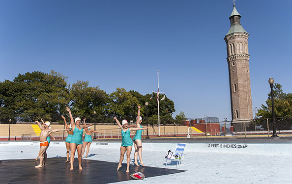dancers perform in a drained-out pool