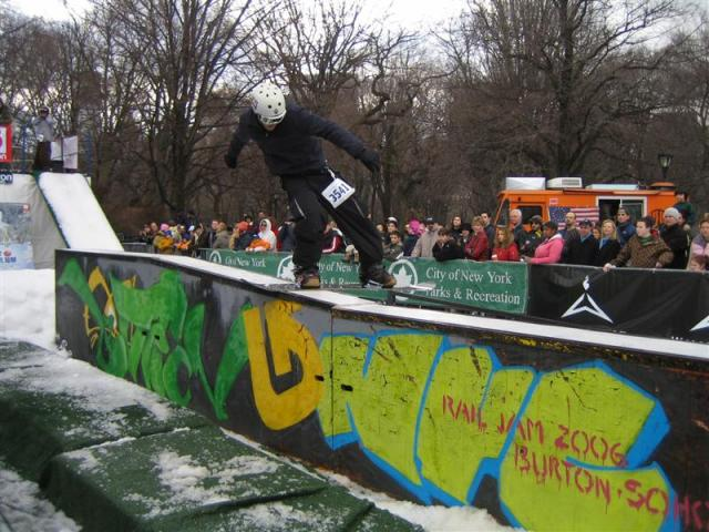 Performers show off their snowboarding skills at a rail jam.