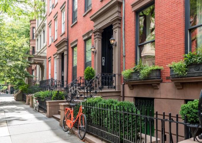 A New York neighborhood street with a bike.