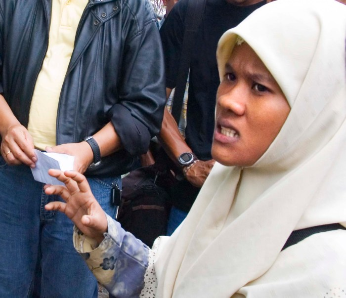 Islamic woman tells Christian Indonesians that they should get our of her village. The religious rhetoric arose   during a property dispute. Photo: A Journey through NYC religions