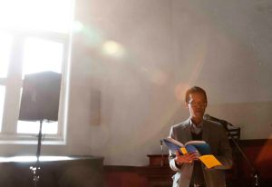 "Jeff Chu reads from his book ""Does Jesus really love me?"" at his church in Brooklyn."
