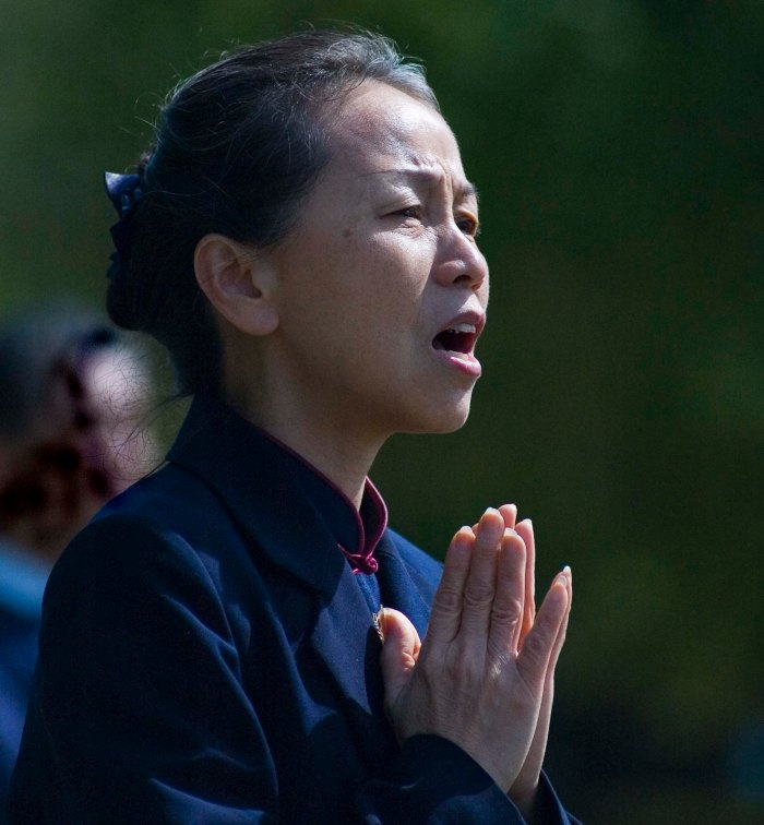 Tzu Chi Buddhist at prayer, Flushing, Queens. Photo: Tony Carnes/A Journey through NYC religions