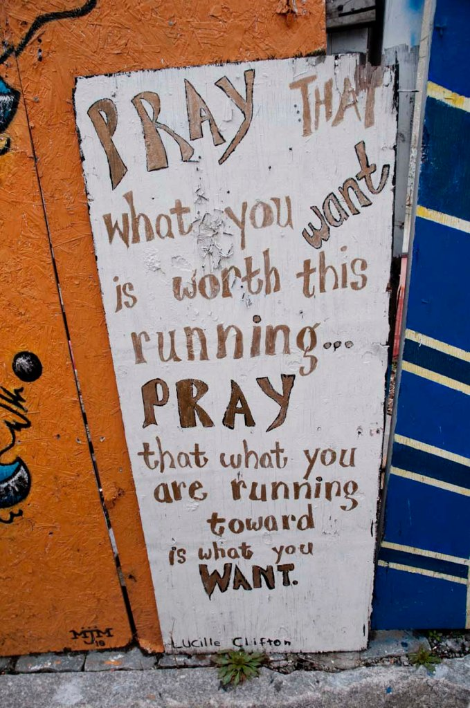 "Grafitti sign: ""Pray that you are running toward what you want."" Crown Heights, Brooklyn. Photo: Tony Carnes/A Journey through NYC religions"