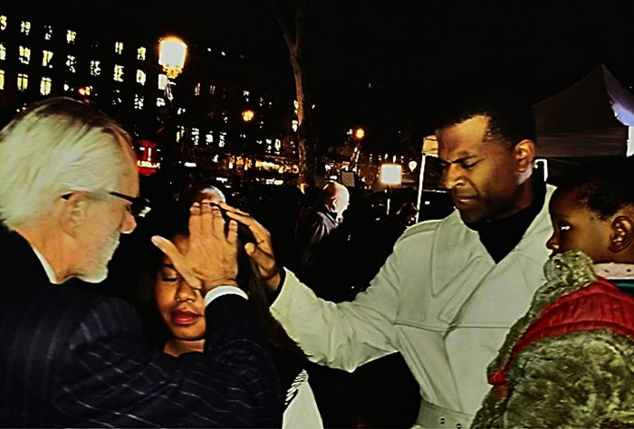 NYC pastors Bill Devlin and Dimas Salaberrios praying with a Parisian young woman.