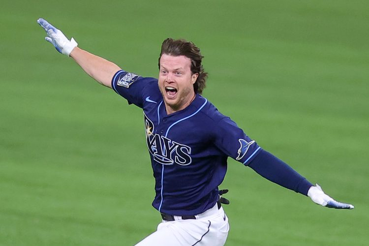 ARLINGTON, TEXAS - OCTOBER 24:  Brett Phillips #14 of the Tampa Bay Rays celebrates after hitting a ninth inning two-run walk-off single to defeat the Los Angeles Dodgers 8-7 in Game Four of the 2020 MLB World Series at Globe Life Field on October 24, 2020 in Arlington, Texas. (Photo by Ronald Martinez/Getty Images)