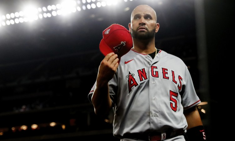 Apr 27, 2021; Arlington, Texas, USA;  Los Angeles Angels first baseman Albert Pujols (5) reacts during the game against the Texas Rangers at Globe Life Field. Mandatory Credit: Kevin Jairaj-USA TODAY Sports
