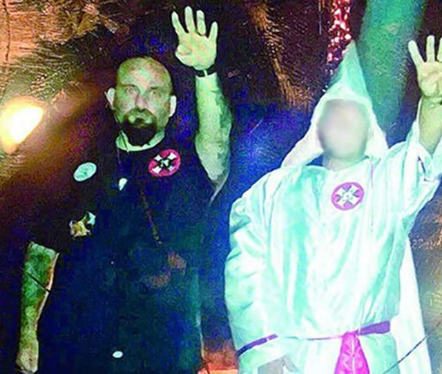 Louisiana Cop Fired After Pictured Giving Nazi Salute At Kkk Rally