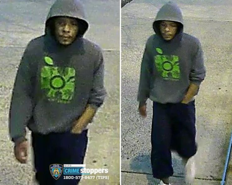 Police on Thursday released a surveillance photo of the suspect wearing a gray hooded sweatshirt with a bright green design on the front.