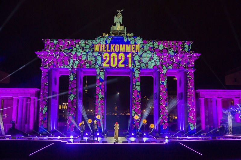 """""""Welcome 2021"""" is projected onto the Brandenburg Gate in Berlin. The New Year's Eve party at the historic landmark was canceled due to the pandemic. (Christoph Soeder/dpa via AP)"""