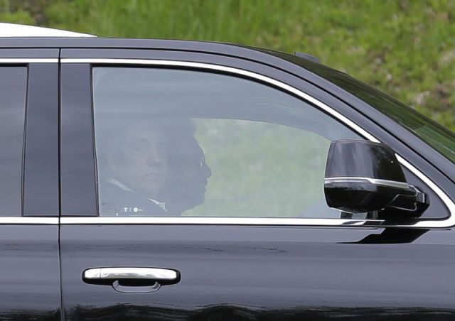 Michael Cohen looks out the window of his car as he arrives at the Federal Correctional Institution in Otisville, N.Y., on Monday.