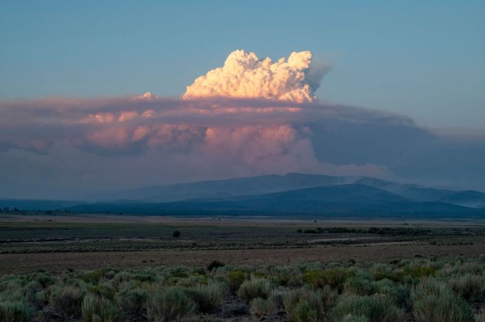 A pyrocumulus cloud from the Bootleg Fire drifts into the air near Bly, Oregon on July 16, 2021. The extreme drought-hit western United States braced for more wildfire destruction as efforts to contain a vast blaze scorching southern Oregon failed to progress, and dangerous dry lightning storms were forecast in California. The Bootleg Fire near Oregon's border with California grew overnight to 240,000 acres, larger than New York City, and by far the biggest active blaze in the U.S. while remaining just seven percent contained.